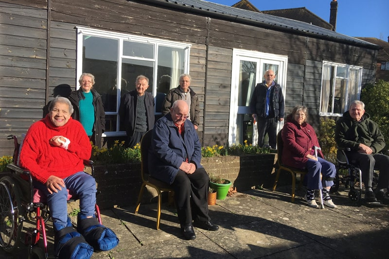 The Phoenix Stroke Club meet outdoors on a sunny day