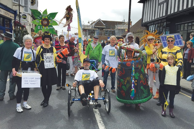 Members of Greening Steyning dress up in colourful costumes to raise awareness of climate issues. There are people dressed as bumble bees, flowers and a beekeeper