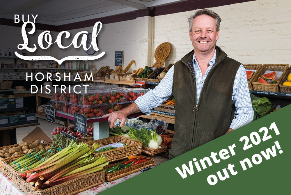The Our District winter 2021 edition features a local businessman in his farm shop as part of the Buy Local Horsham District campaign