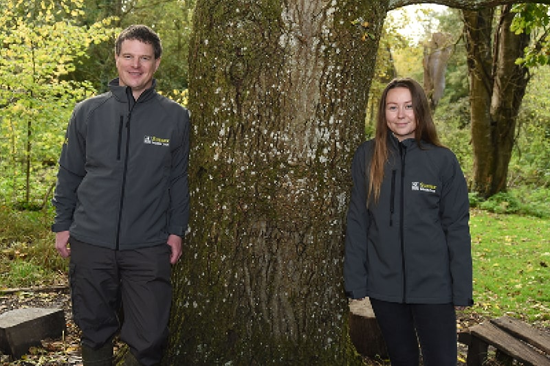 New members of the Wilder Horsham District Team stand either side of a tree