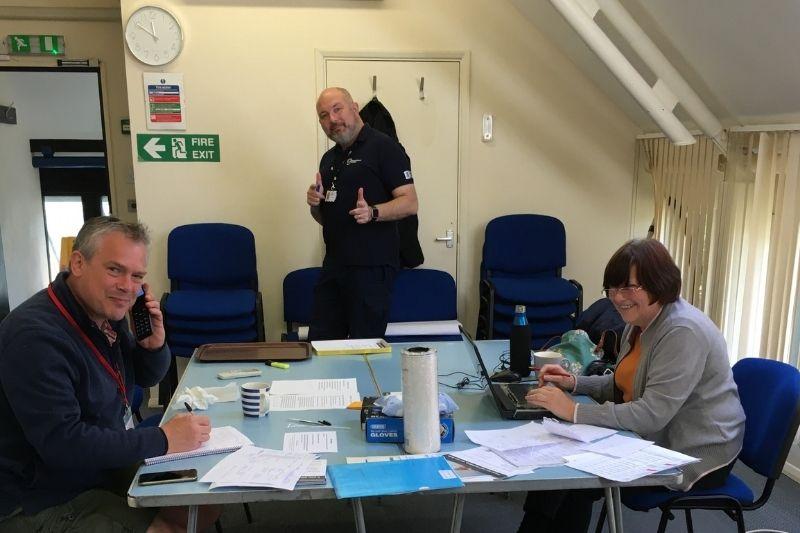 Three community volunteers in their Community Hub office