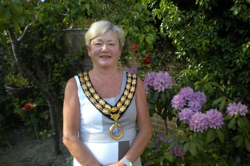 Councillor Kate Rowbottom stands with her Chairman's medallion